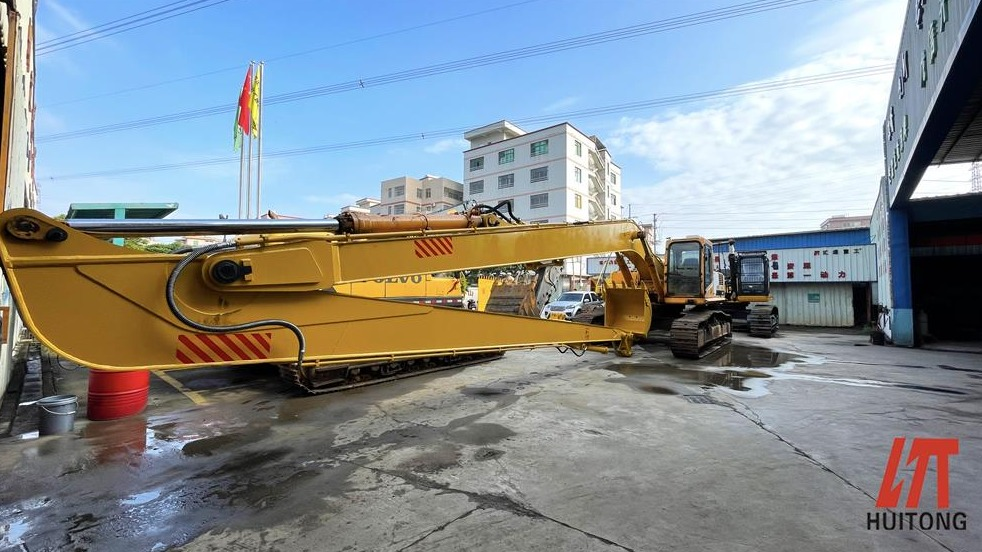 What did the long front boom for excavator pay in this regard