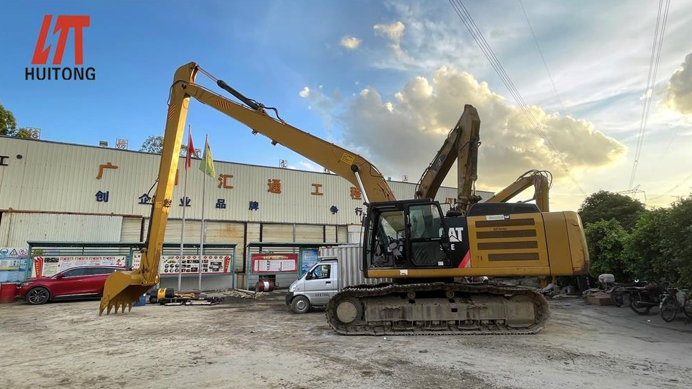 Excavator long front boom assists in urban transformation